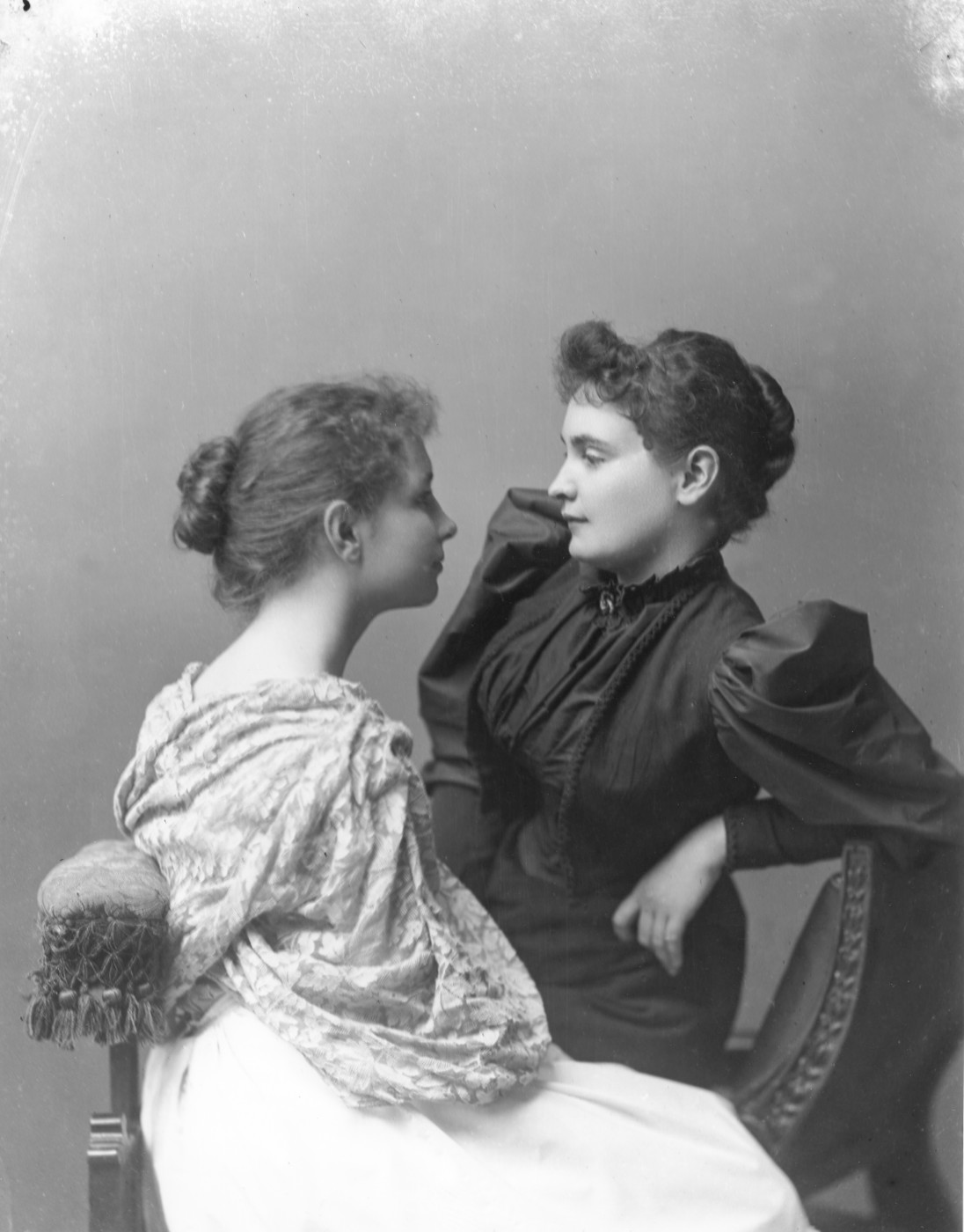 The real helen keller roaring girl productions a monochrome archive photograph shows a teenage helen sitting on a chaise facing a young annie thecheapjerseys Image collections