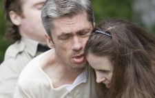 As inmates Thomas and Amelie cling to each other, the Orderly wraps his arms around Thomas' chest to haul him from her.
