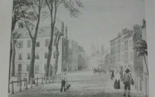 Black and white print taken from a watercolour. A cobbled street and pavement lead around the edge of the Square. A wooden-rail fence on the left marks the boundary of the grassy, tree-lined centre of the Square. The outer edges are lined with elegant three-storey houses. People walk along the pavements to the right of the picture and a horse-drawn carriage makes its way along the street.