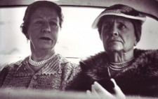 Seated alongside Polly in the rear of a car, both women wear deep frowns, Helen, in her 60s, looks deeply anxious, her mouth downturned.