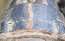 A close up of industrial machinery, painted blue.