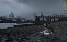Against a backdrop of St Paul's Cathedral and Blackfriars Bridge, dark clouds rolling in, Liz sculpts the figures, almost merging into the dank shingle foreshore.